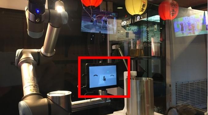 A robot bartender smiling